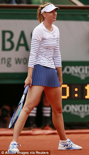 Stylish: She arrived onCourt Philippe Chatrier wearing a short navy shirt with a Nike striped top and visor