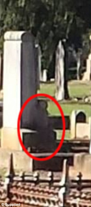 This shadowy figure darkening a monument in Drayton Cemetery is said to be a ghost