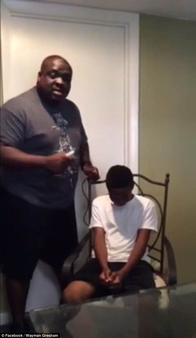 kids time out chair metal outdoor table and chairs father wayman gresham gives pretends to shave his son's head | daily mail online