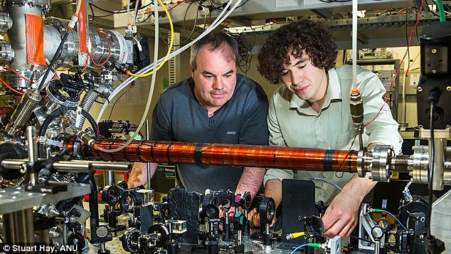 Physicists at the Australian National University recently conducted what is known as the John Wheeler's delayed-choice thought experiment . Pictured is Associate Professor Andrew Truscott (left) with PhD student Roman Khakimov