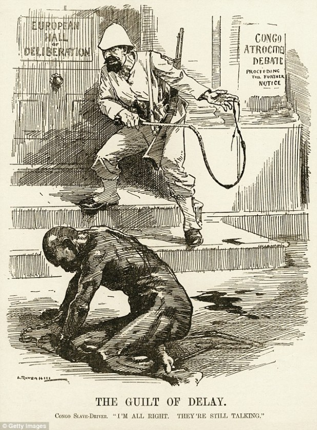 """A political cartoon relating to the treatment of native people in the Congo area of Africa shows an African native that appears to have been tortured by a white man that is standing nearby holding a whip. Published in 1909. The text at the bottom of the cartoon reads: The Guilt of Delay. Congo Slave-Driver, """"I'm all right. They're still talking."""""""
