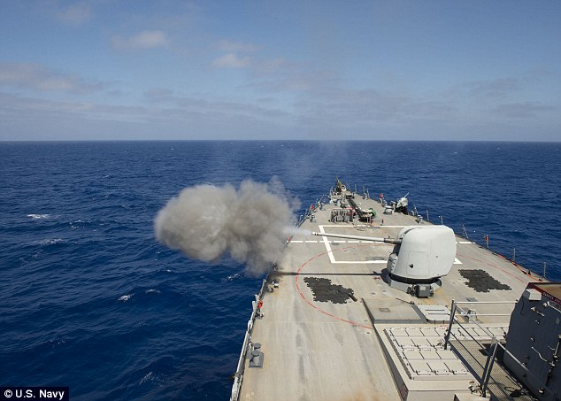 The guided-missile destroyer USS Ross (DDG 71) test fires the MK45 5-inch lightweight gun. US Navy bosses hope they will be able to fire the new HVP weapons