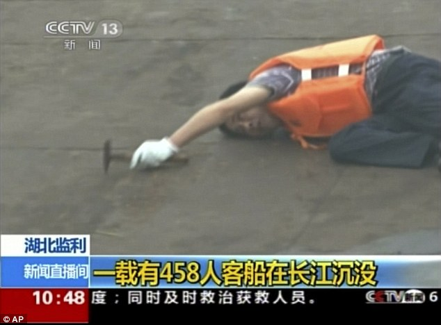 Rescue: State television showed footage of rescuers trying to cut through the ship's hull with an angle grinder