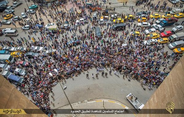 Gathered to watch: The horrific public murders of gay men draw some of the largest crowds in ISIS' self-declared caliphate, with men photographed taking their young sons to watch the regular atrocities