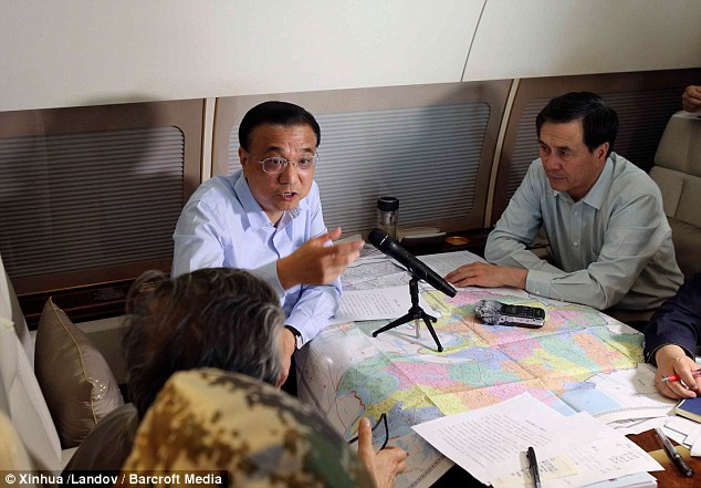 'All-out effort': Chinese prime minister Li Keqiang arrived on the scene on Tuesday to lead rescue operation
