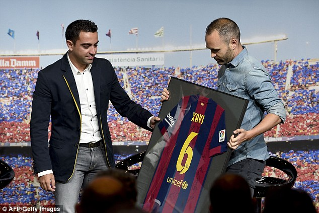 Iniesta, who has been in Barcelona's first team with Xavi since 2002, presented the star with a signed shirt