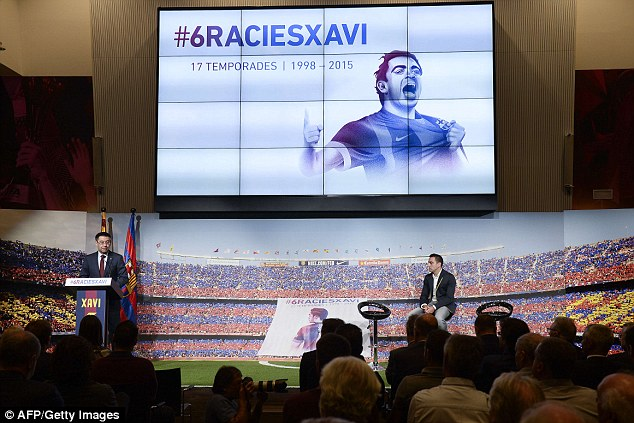 Barcelona president Josep Maria Bartomeu makes a speech as the club celebrate Xavi's career at the club