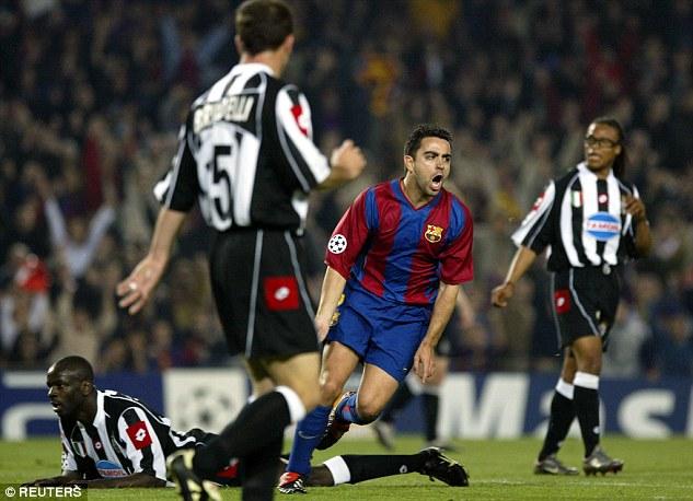 Xavi celebrates after scoring against Juventus' Gianluigi Buffon in a Champions League quarter-final in 2003