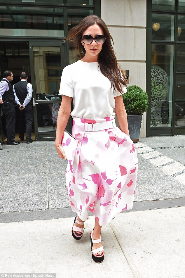 Flower power: Victoria Beckham looked the epitome of elegance as she left her hotel in New York on Thursday