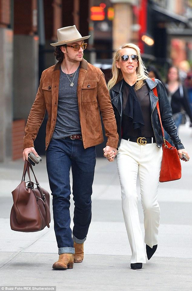 Sam Taylor-Johnson with husband Aaron as she touches down ...