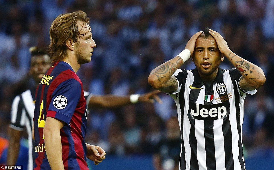 Arturo Vidal (right) was booked early in the first half and was fortunate to remain on the pitch after losing his head in a wayward spell