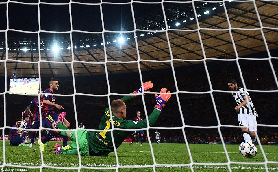 Gerard Pique, Carlos Tevez, Dani Alves, Jordi Alba , Pirlo and Rakitic watch open-mouthed as the Spanish striker sidefoots home