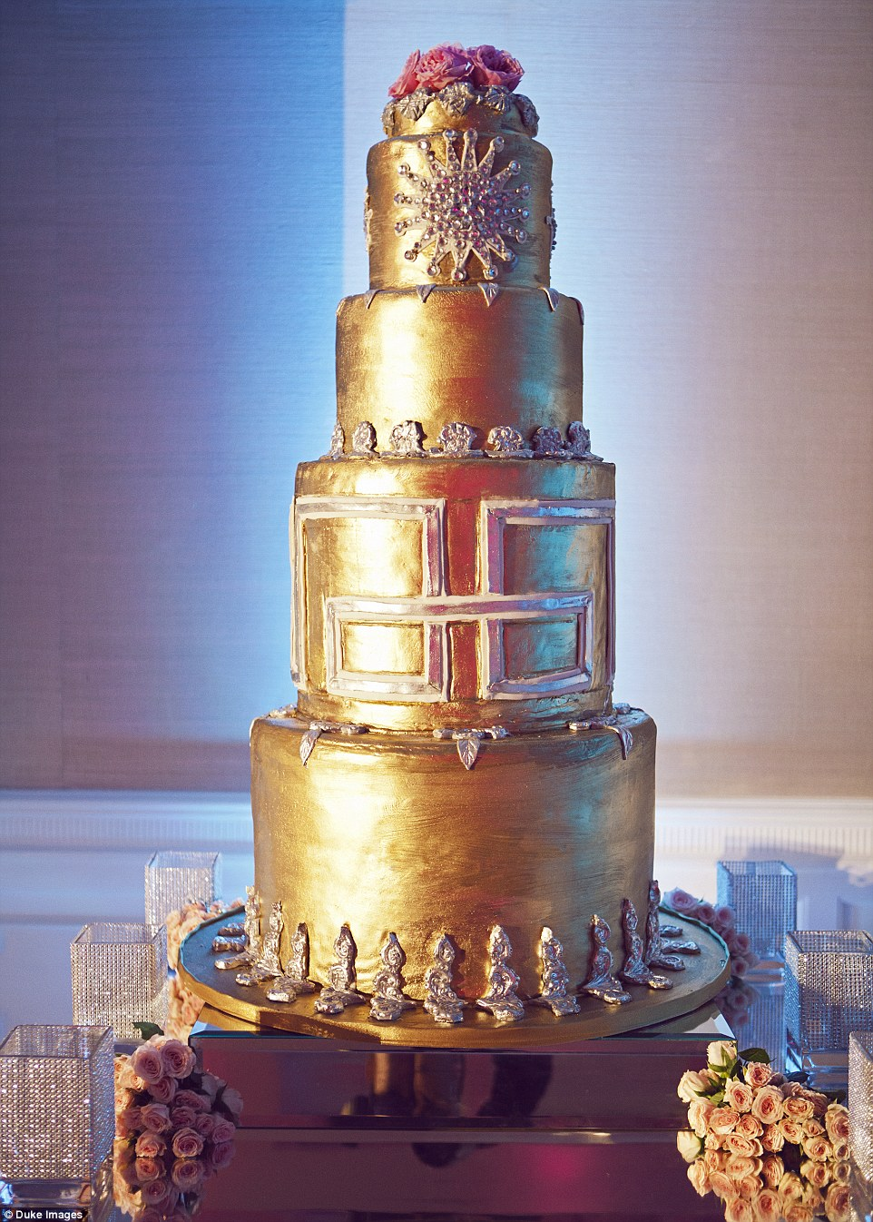 The wedding cake was a glamorous gold art deco design