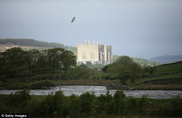 Women under the age of 60, who live downwind from the Trawsfynydd nuclear power station in North Wales (pictured) are at five times greater risk of developing breast cancer, experts have warned