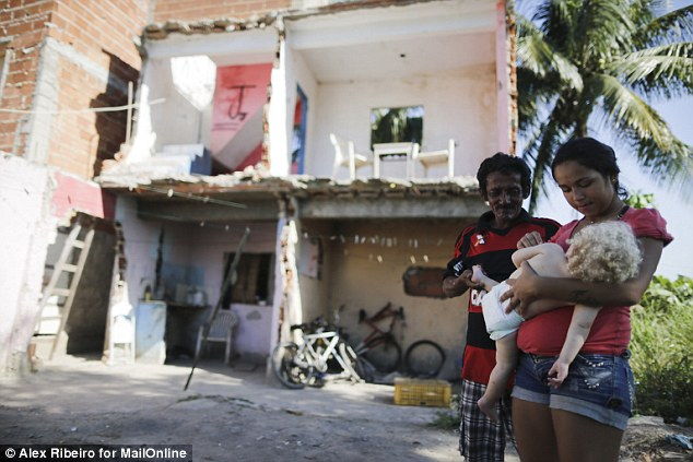Harsh: Luis now lives exposed to the elements with the couple's daughter, Thais, 17, and her baby (pictured with Luis, and their son Igor, 14. Thais said the situation was 'horrible'