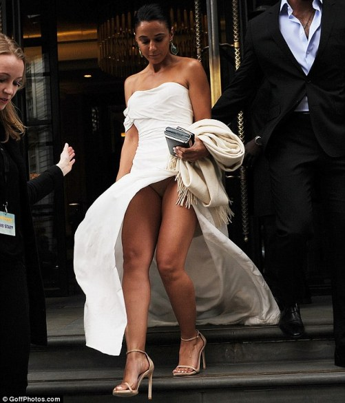 Showing off: Emmanuelle suffered a wardrobe malfunction as she headed to the Entourage premiere