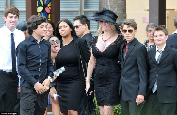 United family: Jackie Siegel with relatives and friends at the funeral in Florida today. Her daughter was just 18 when she died