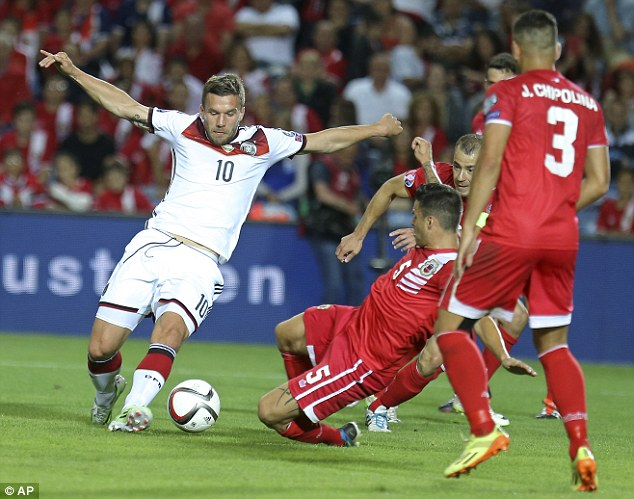 Arsenal forward Lukas Podolski, evading a series of tackles, entered the field of play late in the second-half