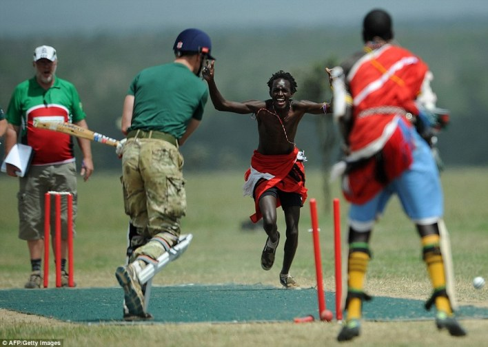 He's out: A team member of the Maasai Cricket Warriors celebrates the dismissal of a player in the British Army Training Unit team