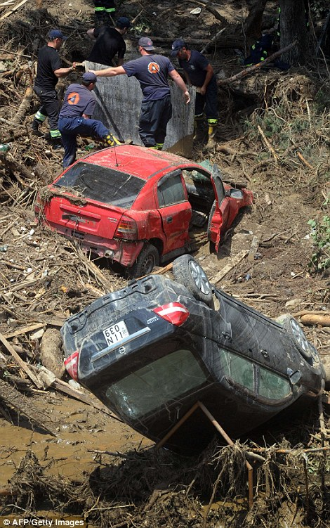Rescuers are still trawling through the city looking for bodies and any survivors in the disaster, which destroyed cars, roads and infrastructure