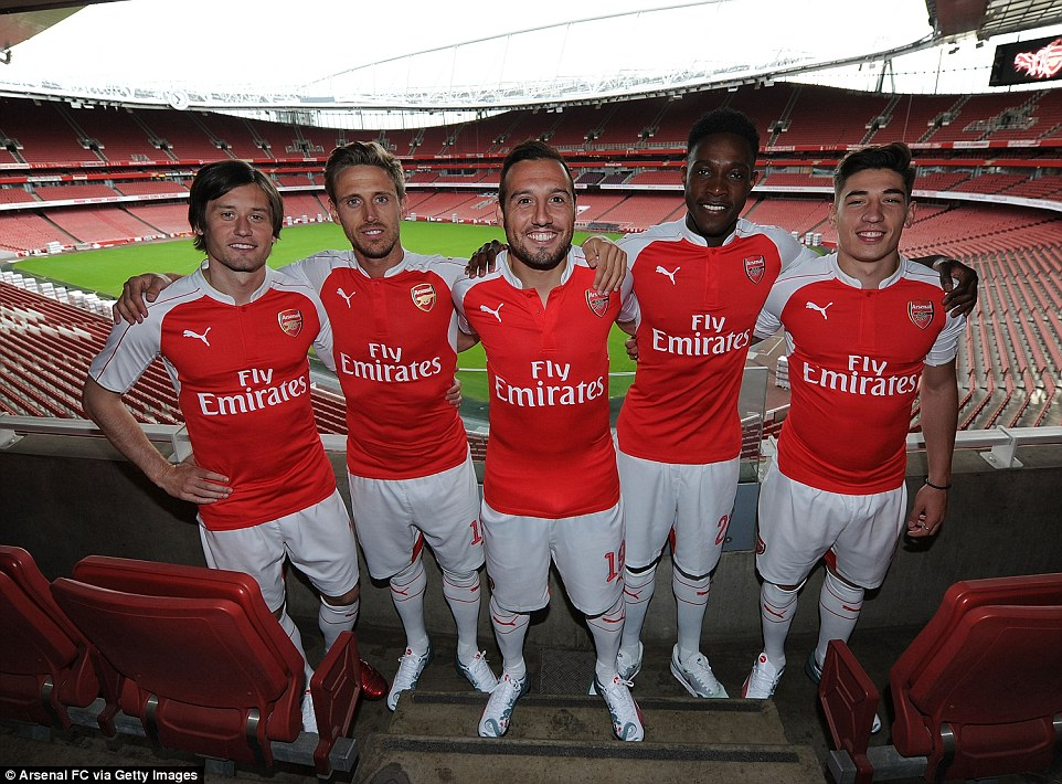 The five Arsenal players pose inside the stadium - the new Arsenal home kit will be on sale on June 25
