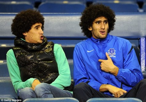 Mansour (left) and Marouane look on from the stands during Everton's game against Leyton Orient in 2012