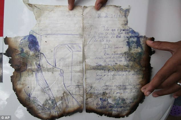 Narcissistic confession: Parts of his book, found at Negromonte's address but damaged after angry neighbours set fire to the home, spelled out the details of their crimes