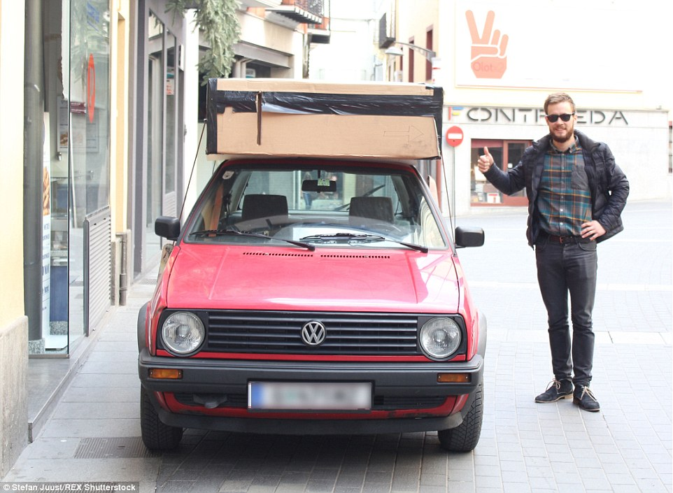 The metallic-looking box can be wrapped and strapped to the roof of a car, and eliminates the need to buy new furniture