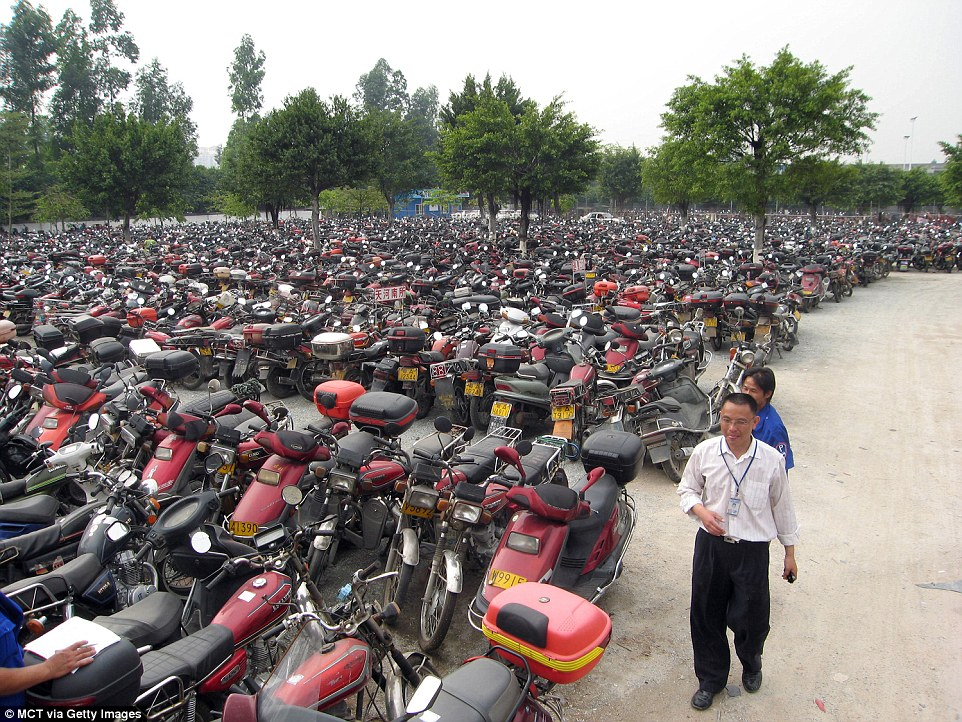 Chinese car graveyard of vehicles deemed too toxic to be
