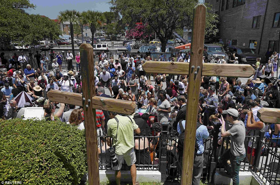 Prayers: Mourners gather outside Morris Brown AME Church for a vigil the day after a mass shooting in Charleston