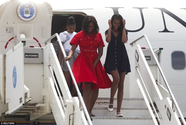 Wardrobe malfunction: Michelle Obama almost had a Marilyn Monroe moment as she stepped off her plane today in Venice