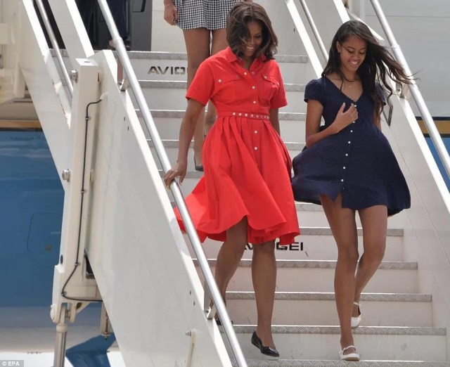 Same problem: Malia Obama also had to catch her skirt as it blew up