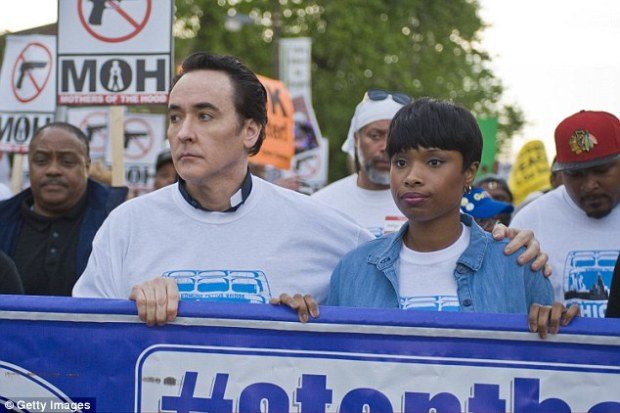 Showing support: John Cusack and Jennifer Hudson joined the annual end of the school year peace march of St. Sabina Church on Friday to show their support and to film scenes for upcoming film Chiraq