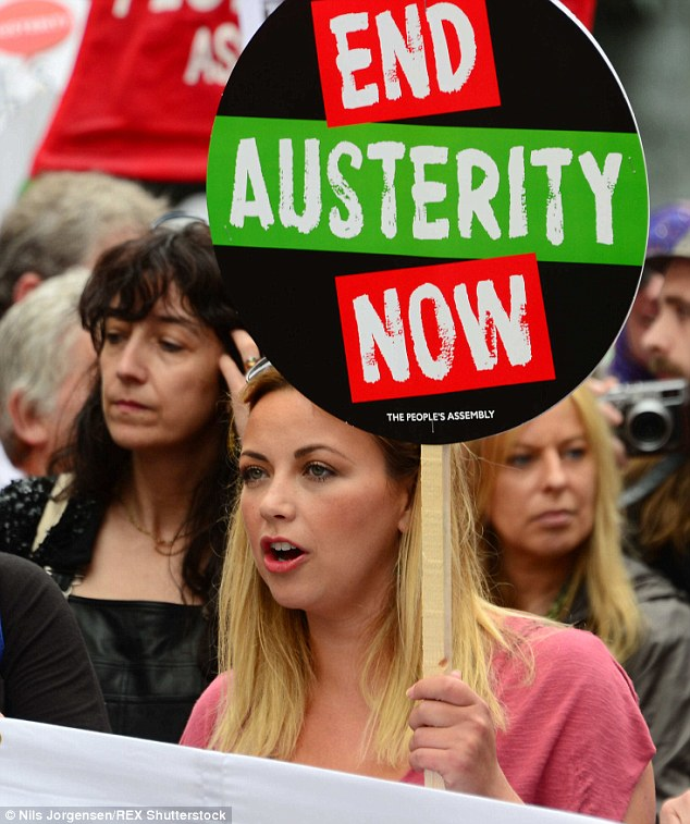 The singer, who has an estimated net worth of £11million, brandished an End Austerity Now placard