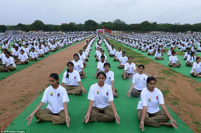 National Cadet Corps (NCC) participate in a mass yoga session  at the parade grounds in Secunderabad, the twin city of Hyderabad