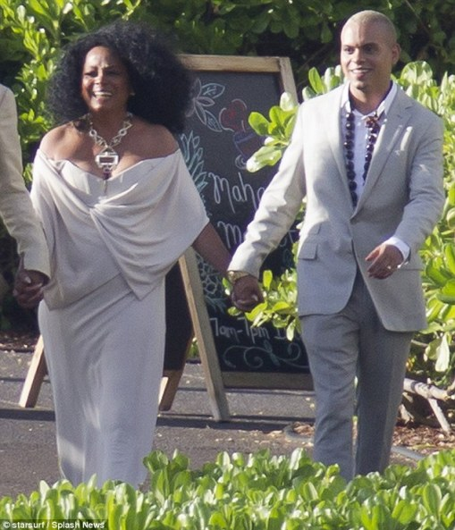 A family affair: The diva held hands with son Evan (who is married to Ashlee Simpson) as they made their way to the reception