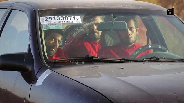 Moments from death: The as-yet-unnamed victims were filmed sitting in the locked car before it is destroyed