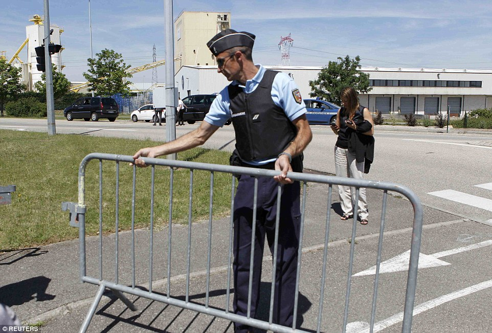 Barrier: A French Gendarme blocks the access road to the Saint-Quentin-Fallavier industrial area following the terror attack