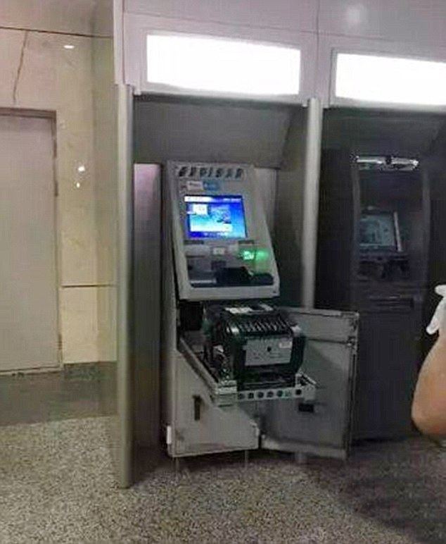 Unbelievable: Workers at the bank were surprised that anyone could break the cash machine by hand