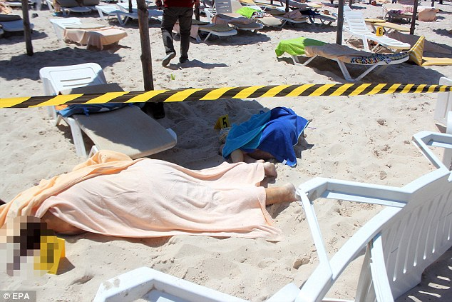 Bodies lie on a beach in Sousse after gunmen opened fire on tourists at two hotels, killing at least 37