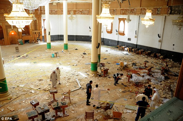 Carnage: Medics and security forces gather inside the Imam Sadiq Mosque attempt to secure the scene following the devastating blast in Kuwait