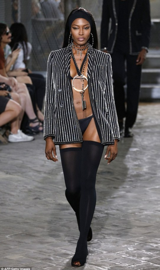 Youthful: Naomi Campbell took to the runway in her teeny underwear at Givenchy during the Men's Spring/Summer collection fashion show in Paris on Thursday