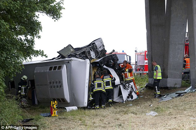 The scene of the coach crash in Belgium, where more than 30 British children were on board leaving the driver dead and others injured