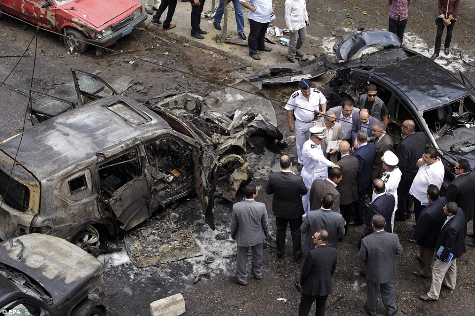 Local security staff and civilians inspect the remains of the bomb site. According to local sources, the attack may have been the actions of the 'Giza Popular Resistance'