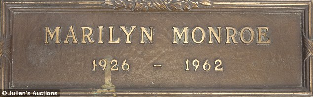 Big money:Monroe's grave marker (above), expected to go for $2,000 - $4,000, sold for $212,500