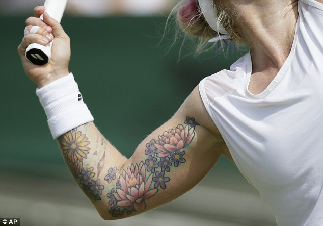 When she moved to serve, the colourful tattoo on Bethanie's arm was on full display