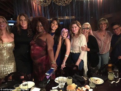 Party time: The reality star, second from left, appeared to be enjoying her new found status as an advocate for the trans communtiy