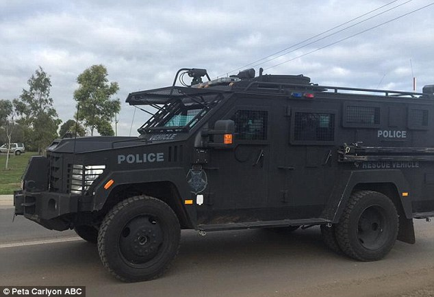 Heavy duty: A police armoured-vehicle arrives at the prison