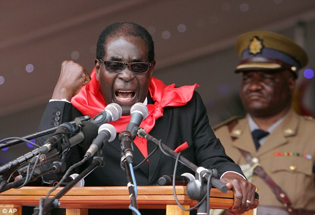 Leader: Preisdent of Zimbabwe Robert Mugabe, who is known for his brutal crusades against gay people, has mocked America's decision to legalise gay marriage across all 50 states by proposing to Barack Obama