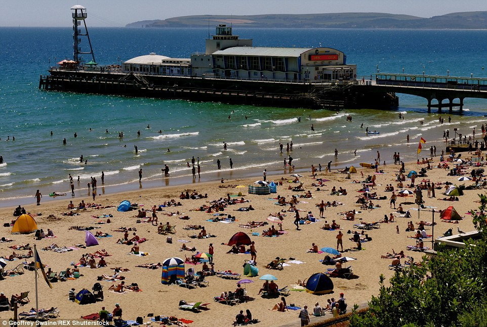 Feeling hot, hot, hot! Hundreds of people turned out toBournemouth beach as the Met Office confirmed the mercury hit 29C by 2pm